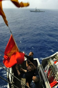 Sailors hoisting signal flags