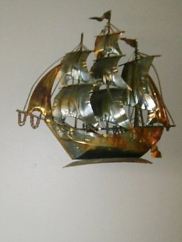 brass metal boat wall hanging